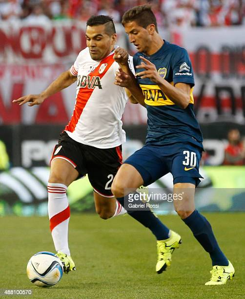 Gabriel Mercado of River Plate fights for the ball with Rodrigo Bentancur of Boca Juniors during a match between River Plate and Boca Juniors as part...