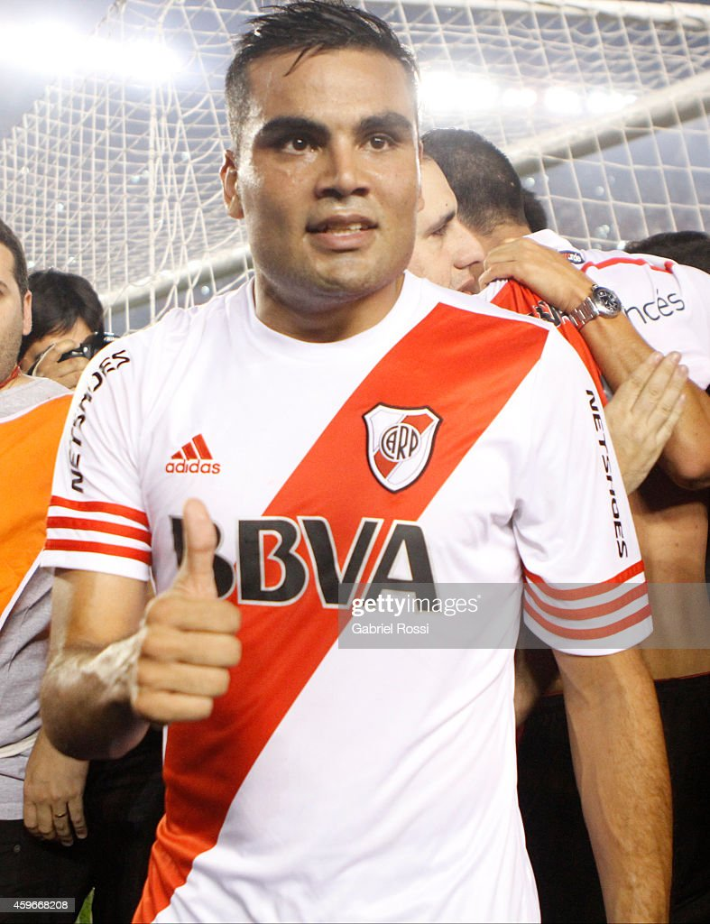 <a gi-track='captionPersonalityLinkClicked' href=/galleries/search?phrase=Gabriel+Mercado&family=editorial&specificpeople=4110696 ng-click='$event.stopPropagation()'>Gabriel Mercado</a> of River Plate gives a thumb up after winning a second leg semifinal match between River Plate and Boca Juniors as part of Copa Total Sudamericana 2014 at Monumental Antonio Vespucio Liberti Stadium on November 27, 2014 in Buenos Aires, Argentina.