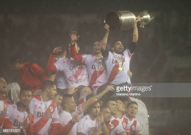 Gabriel Mercado of River Plate lifts the trophy after winning the final match between River Plate and Tigres UANL as part of Copa Bridgestone...