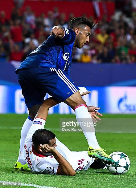 Gabriel Mercado of Sevilla FC competes for the ball with Corentin Tolisso of Olympique Lyonnais during the UEFA Champions League Group H match...