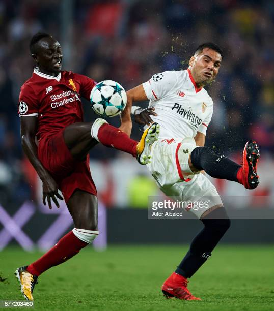 Gabriel Mercado of Sevilla FC duels for the ball with Sadio Mane of Liverpool FC during the UEFA Champions League group E match between Sevilla FC...