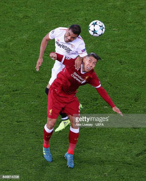 Gabriel Mercado of Sevilla FC wins the ball from Roberto Firmino of Liverpool FC during the UEFA Champions League group E match between Liverpool FC...