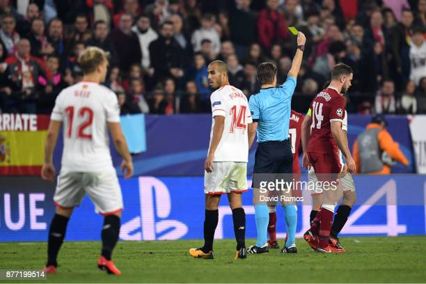 Gabriel Mercado of Sevilla is shown a yellow card by referee during the UEFA Champions League group E match between Sevilla FC and Liverpool FC at...
