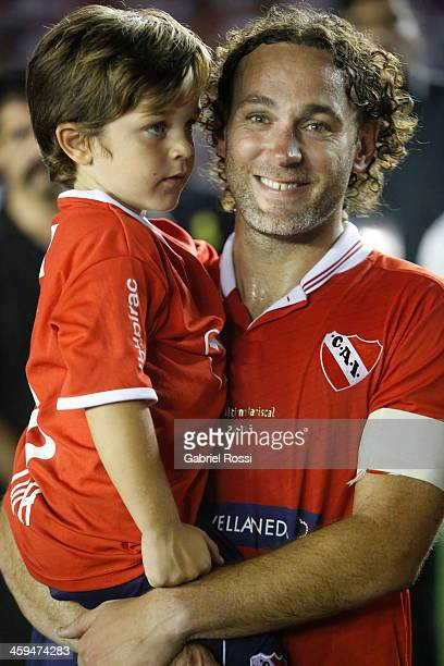 Gabriel Milito and his son watch a video from Barcelona's players after his farewell match between Independiente 2002 and Los Amigos de Milito at...