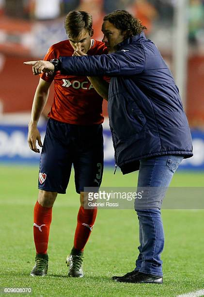 Gabriel Milito coach of Independiente gives instructions to Nicolas Tagliafico of Independiente during a first leg match between Independiente and...