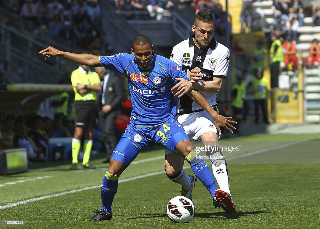 Gabriel Moises Antunes Da Silva of Udinese Calcio competes for the ball with Aleandro Rosi of Parma FC during the Serie A match between Parma FC and Udinese Calcio at Stadio Ennio Tardini on April 14, 2013 in Parma, Italy.