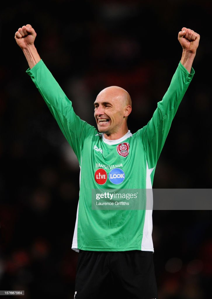 Gabriel Muresan of CFR 1907 Cluj celebrates at the end of the UEFA Champions League Group H match between Manchester United and CFR 1907 Cluj at Old Trafford on December 5, 2012 in Manchester, England.