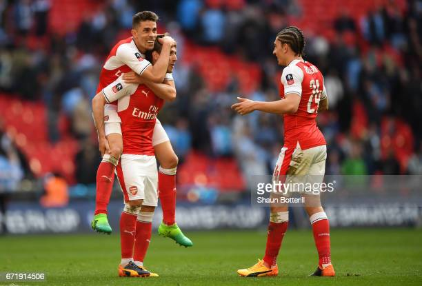 Gabriel Nacho Monreal and Hector Bellerin of Arsenal celebrate their 21 victory after the Emirates FA Cup SemiFinal match between Arsenal and...