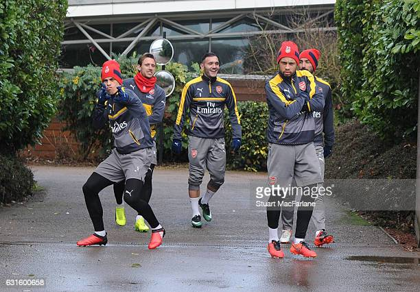 Gabriel Nacho Monreal Lucas Perez and Francis Coquelin of Arsenal with ex player Robert Pires before a training session at London Colney on January...