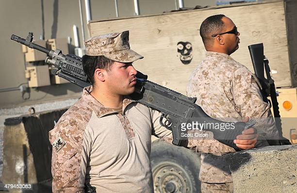 Gabriel Nazarioramirez and CE1 Sammy Hill with the US Navy Seabees from Naval Mobile Construction Battalion 28 listen to a post mission brief...
