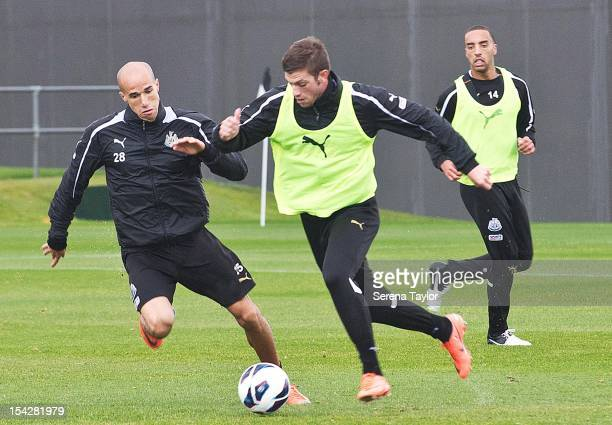 Gabriel Obertan and Davide Santon compete for a ball during a Newcastle United training session at The Little Benton training ground on October 17...