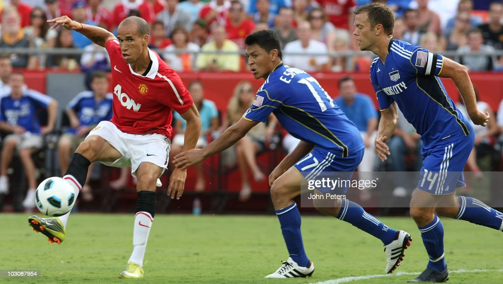 Gabriel Obertan of Manchester United clashes with Roger Espinoza of Kansas City Wizards during the pre-season friendly match between Kansas City Wizards and Manchester United at Arrowhead Stadium on July 25, 2010 in Kansas City, Missouri.