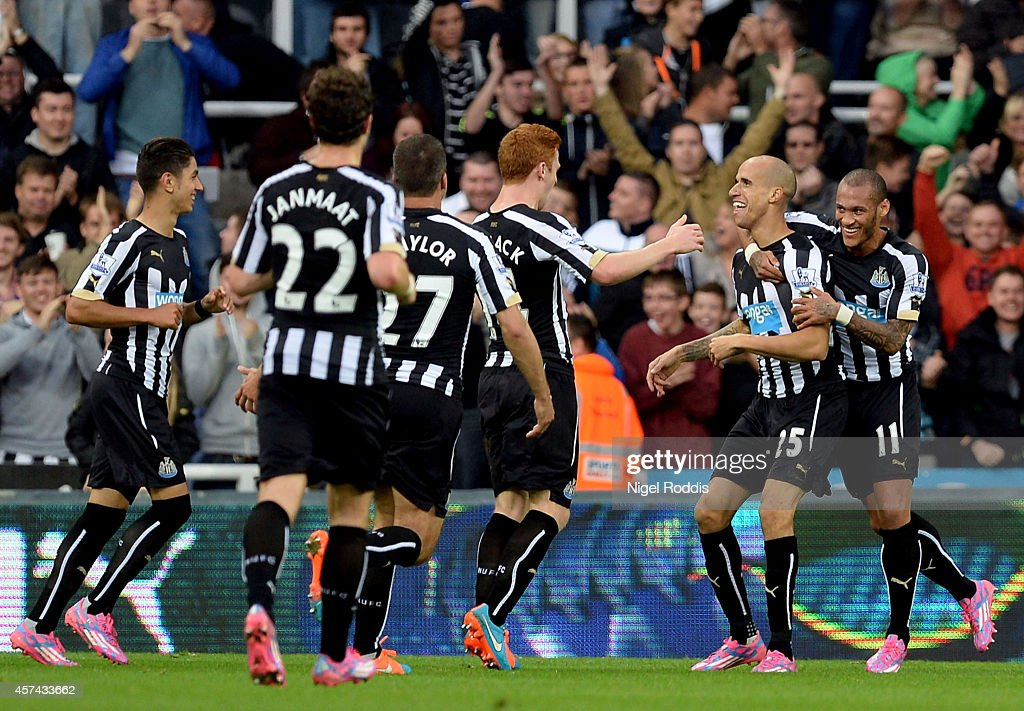 Gabriel Obertan#25 (2nd R) of Newcastle United is conatulated by teammates after scoring the opening goal during the Barclays Premier League match between Newcastle United and Leicester City at St James' Park on October 18, 2014 in Newcastle upon Tyne, England.