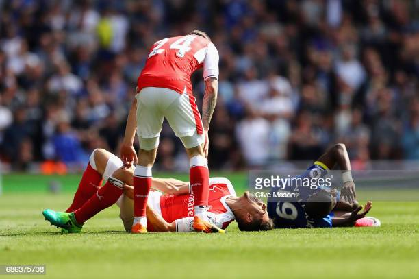 Gabriel of Arsenal and Enner Valencia of Everton on the ground after a tackle during the Premier League match between Arsenal and Everton at Emirates...