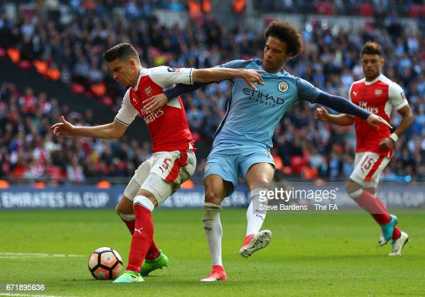 Gabriel of Arsenal and Leroy Sane of Manchester City compete for the ball during the Emirates FA Cup SemiFinal match between Arsenal and Manchester...