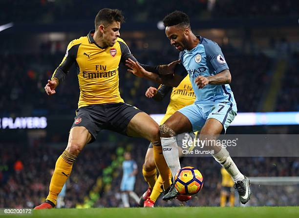 Gabriel of Arsenal and Raheem Sterling of Manchester City battle for possession during the Premier League match between Manchester City and Arsenal...
