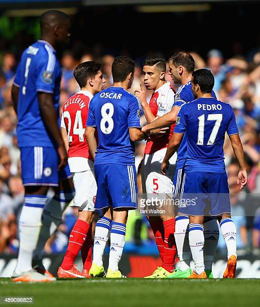 Gabriel of Arsenal argues with Oscar of Chelsea after being shown a red card during the Barclays Premier League match between Chelsea and Arsenal at...
