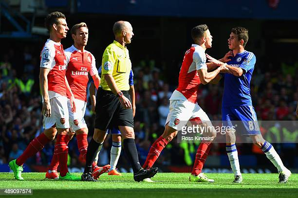 Gabriel of Arsenal argues with Oscar of Chelsea during the Barclays Premier League match between Chelsea and Arsenal at Stamford Bridge on September...