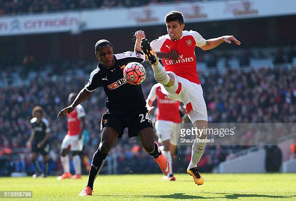 Gabriel of Arsenal battles with Odion Ighalo of Watford during the Emirates FA Cup sixth round match between Arsenal and Watford at Emirates Stadium...