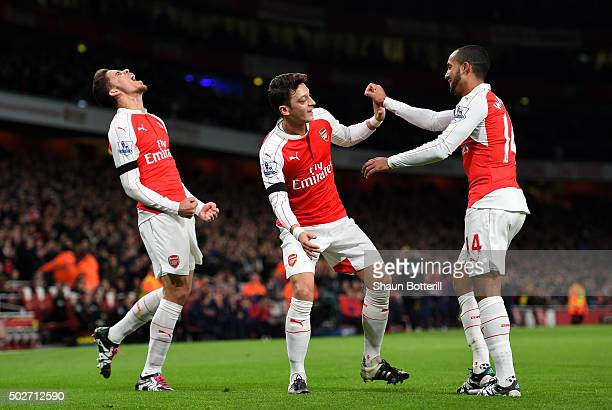 Gabriel of Arsenal celebrates scoring his team's first goal with his team mates Mesut Ozil and Theo Walcott during the Barclays Premier League match...