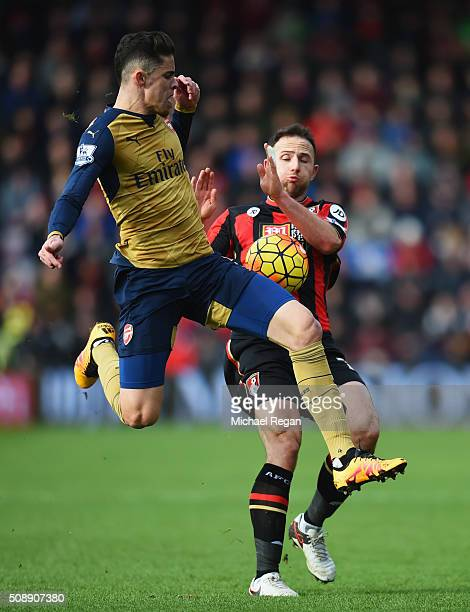 Gabriel of Arsenal challenges Marc Pugh of Bournemouth during the Barclays Premier League match between AFC Bournemouth and Arsenal at the Vitality...