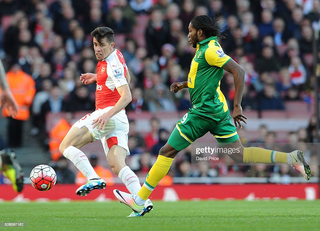 Gabriel of Arsenal clears the ball under pressure from <a gi-track='captionPersonalityLinkClicked' href=/galleries/search?phrase=Dieumerci+Mbokani&family=editorial&specificpeople=4528520 ng-click='$event.stopPropagation()'>Dieumerci Mbokani</a> of Norwich during the Barclays Premier League match between Arsenal and Norwich City at on April 30th, 2016 in London, England