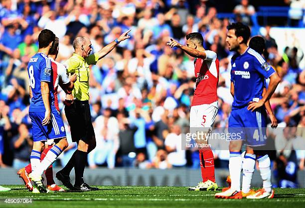 Gabriel of Arsenal is shown a red card bu referee Mike Dean during the Barclays Premier League match between Chelsea and Arsenal at Stamford Bridge...