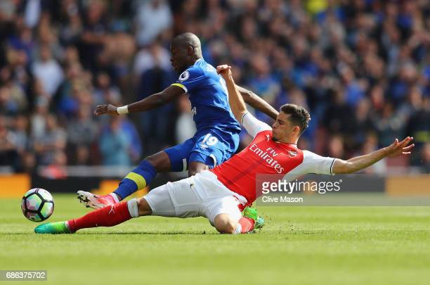 Gabriel of Arsenal tackles Enner Valencia of Everton resulting in Gabriel being stretchered off during the Premier League match between Arsenal and...