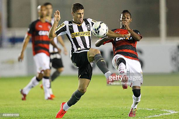 Gabriel of Botafogo battles for the ball with Marquinhos of Vitoria during the match between Botafogo and Vitoria as part of Brazilian Series A 2014...