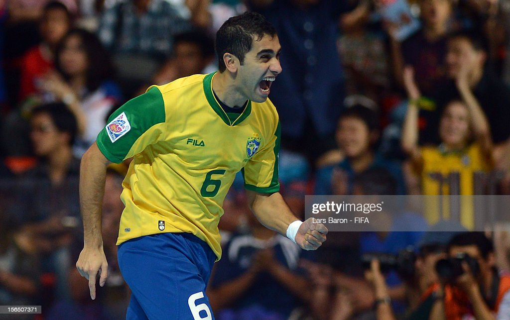 Gabriel of Brazil celebrates after scoring his teams first goal during the FIFA Futsal World Cup SemiFinal match between Brazil and Colombia at...