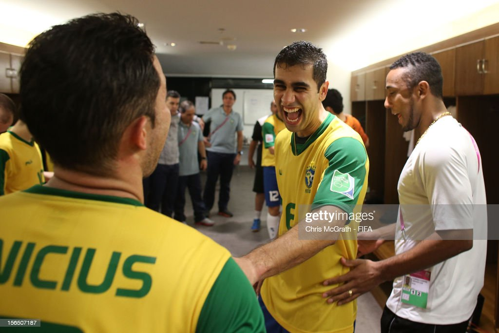 Gabriel of Brazil celebrates with team mates in the dressing room after defeating Colombia during the FIFA Futsal World Cup SemiFinal match between...