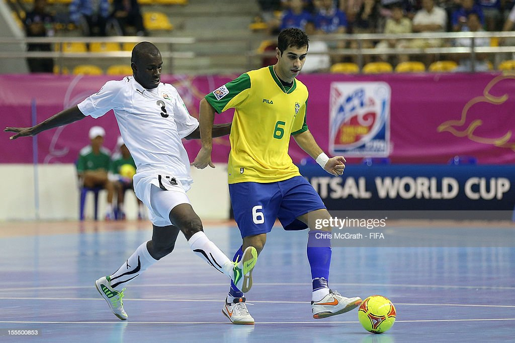 Gabriel #6 of Brazil makes a break past Bader Hasan #3 of Libya during the FIFA Futsal World Cup, Group C match between Brazil and Libya at Korat Chatchai Hall on November 4, 2012 in Nakhon Ratchasima, Thailand.