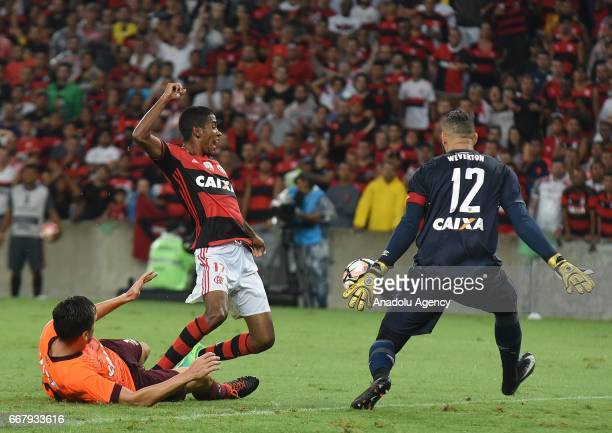 Gabriel of Flamengo in action against Paulo Andre of Atletico Paranaense during a match between Flamengo and Atletico Paranaense as part of Copa...