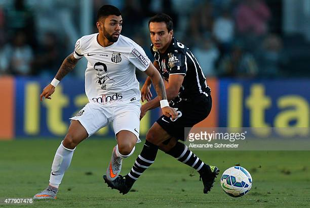 Gabriel of Santos and Jadson of Corinthiansin action during the match between Santos and Corinthians for the Brazilian Series A 2015 at Vila Belmiro...