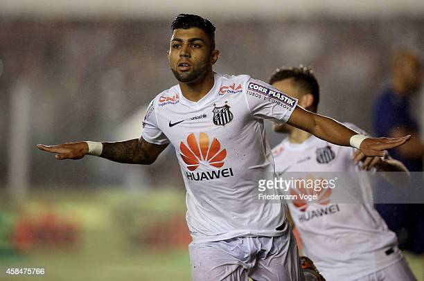 Gabriel of Santos celebrates scoring the second goal during the match between Santos and Cruzeiro for Copa do Brasil 2014 at Vila Belmiro Stadium on...
