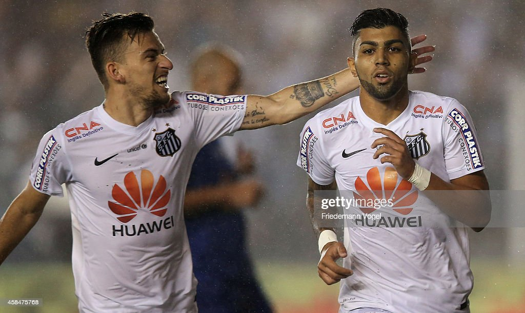 Gabriel of Santos celebrates scoring the second goal with Lucas Lima during the match between Santos and Cruzeiro for Copa do Brasil 2014 at Vila...