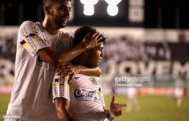 Gabriel of Santos celebrates scoring the third goal with Stefano Yuri during the match between Santos and Mixto as part of Copa do Brasil 2014 at...