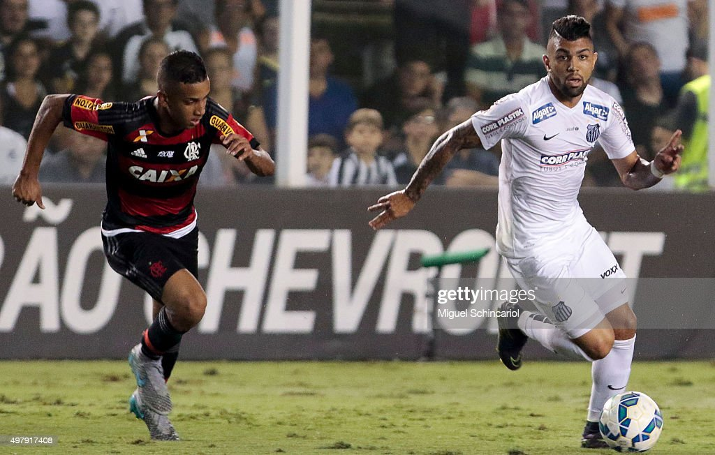 Gabriel of Santos fights for the ball with Jorge of Flamengo during a match between Santos v Flamengo of Brasileirao Series A 2015 at Vila Belmiro...
