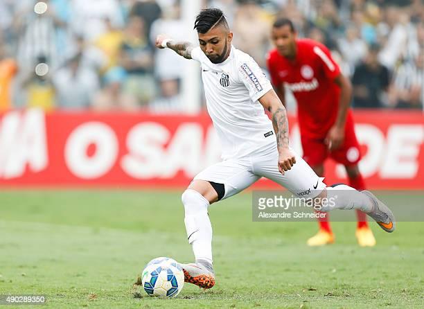 Gabriel of Santos scores their second goal during the match between Santos and Internacional for the Brazilian Series A 2015 at Vila Belmiro stadium...
