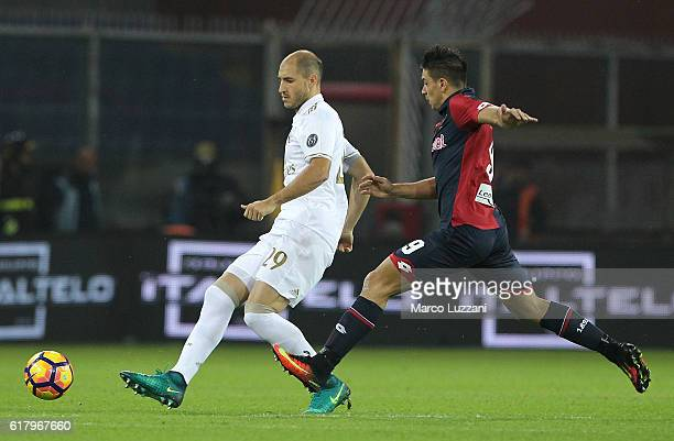 Gabriel Paletta of AC Milan is challenged by Giovanni Simeone of Genoa CFC during the Serie A match between Genoa CFC and AC Milan at Stadio Luigi...