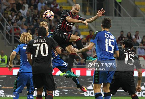 Gabriel Paletta of AC Milan scores his goal during the Serie A match between AC Milan and US Sassuolo at Stadio Giuseppe Meazza on October 2 2016 in...