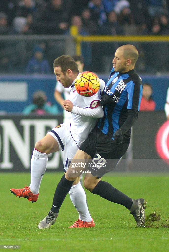 <a gi-track='captionPersonalityLinkClicked' href=/galleries/search?phrase=Gabriel+Paletta&family=editorial&specificpeople=747556 ng-click='$event.stopPropagation()'>Gabriel Paletta</a> (R) of Atalanta BC competes with Diego Angel Capel Trinidad of Genoa CFC during the Serie A match between Atalanta BC and Genoa CFC at Stadio Atleti Azzurri d'Italia on January 10, 2016 in Bergamo, Italy.