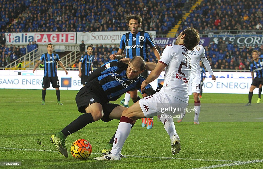 Gabriel Paletta of Atalanta BC is challenged by Emiliano Moretti of Torino FC during the Serie A match between Atalanta BC and Torino FC at Stadio Atleti Azzurri d'Italia on November 22, 2015 in Bergamo, Italy.