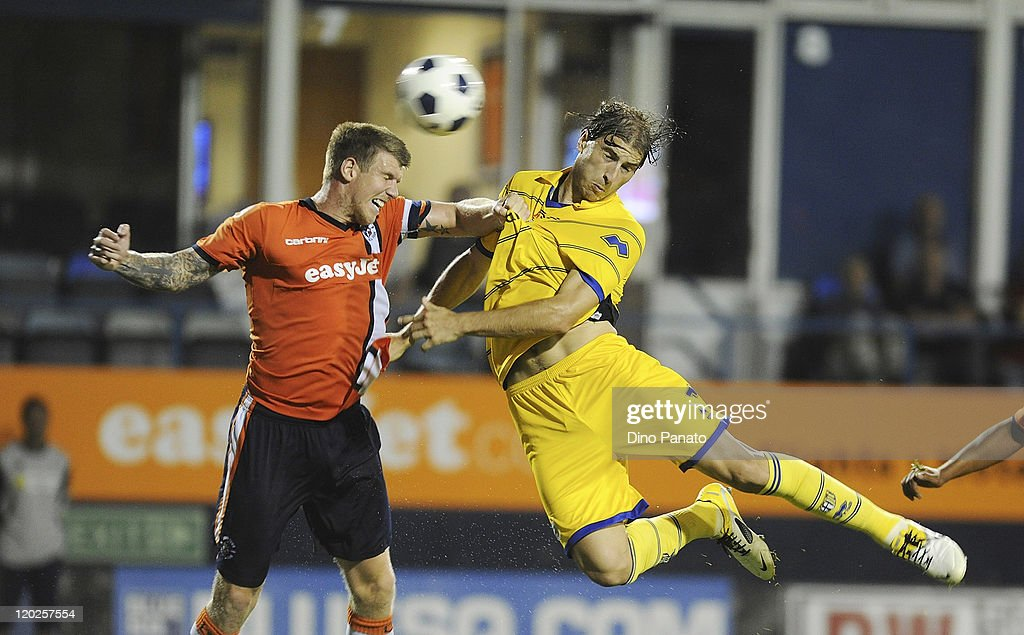<a gi-track='captionPersonalityLinkClicked' href=/galleries/search?phrase=Gabriel+Paletta&family=editorial&specificpeople=747556 ng-click='$event.stopPropagation()'>Gabriel Paletta</a> (R) of Parma battles for the ball in the air with Dean Beckwith of Luton Town during a pre season friendly match between Luton Town and FC Parma at Kenilworth Road on August 2, 2011 in Luton, England.