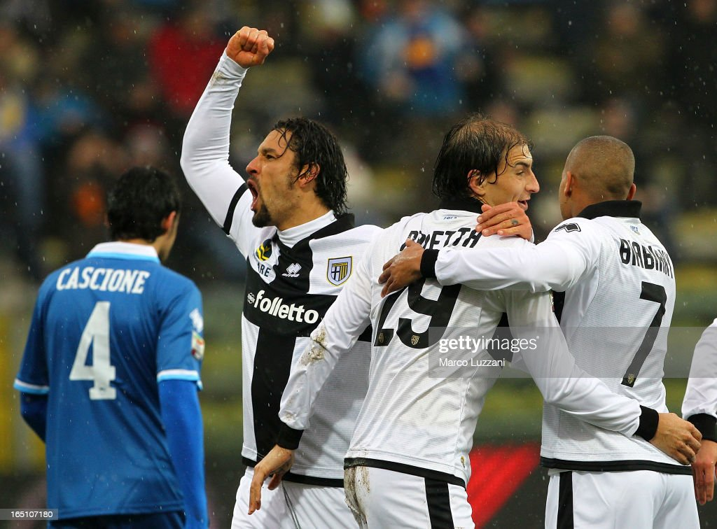 Gabriel Paletta (C) of Parma FC celebrates with Amauri Carvalho De Oliveira (L) and Jonathan Biabiany after scoring the opening goal during the Serie A match between Parma FC and Pescara at Stadio Ennio Tardini on March 30, 2013 in Parma, Italy.