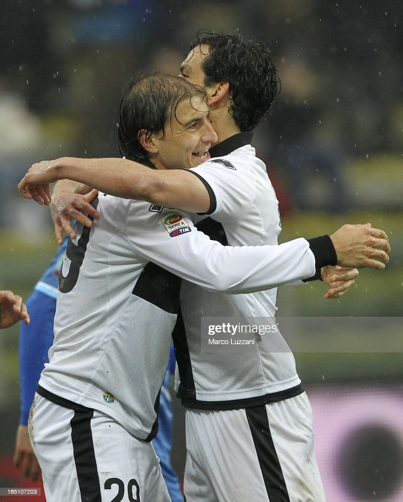 <a gi-track='captionPersonalityLinkClicked' href=/galleries/search?phrase=Gabriel+Paletta&family=editorial&specificpeople=747556 ng-click='$event.stopPropagation()'>Gabriel Paletta</a> of Parma FC celebrates with <a gi-track='captionPersonalityLinkClicked' href=/galleries/search?phrase=Marco+Parolo&family=editorial&specificpeople=6474753 ng-click='$event.stopPropagation()'>Marco Parolo</a> (R) after scoring the opening goal during the Serie A match between Parma FC and Pescara at Stadio Ennio Tardini on March 30, 2013 in Parma, Italy.