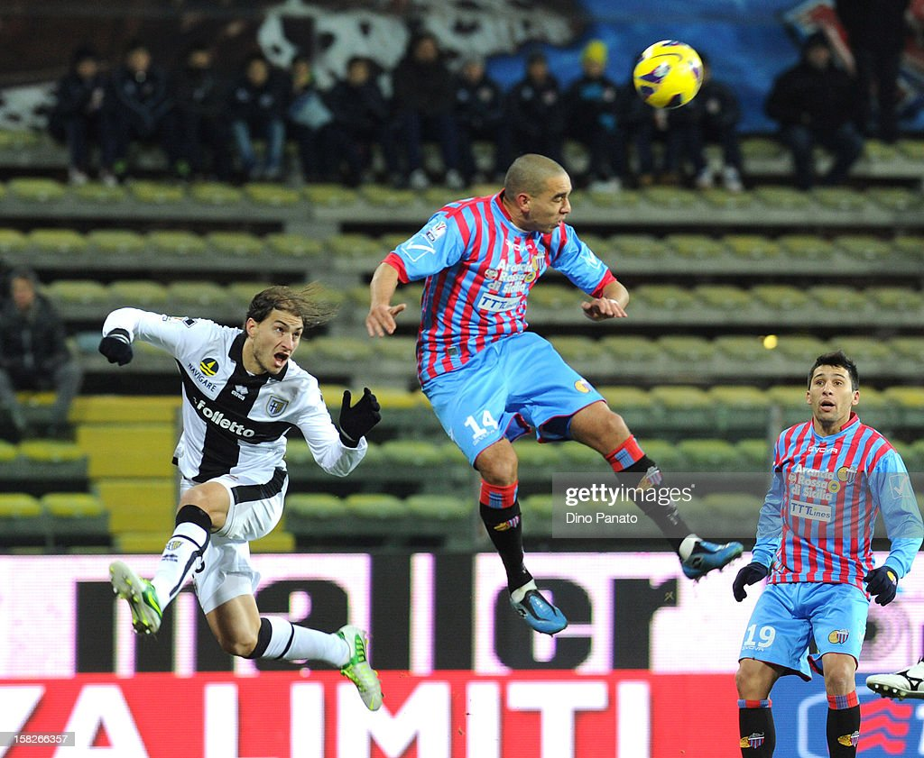 <a gi-track='captionPersonalityLinkClicked' href=/galleries/search?phrase=Gabriel+Paletta&family=editorial&specificpeople=747556 ng-click='$event.stopPropagation()'>Gabriel Paletta</a> (L) of Parma FC competes with Giuseppe Bellusci of Catania Calcio during the TIM Cup match between Parma FC and Catania Calcio at Stadio Ennio Tardini on December 12, 2012 in Parma, Italy.