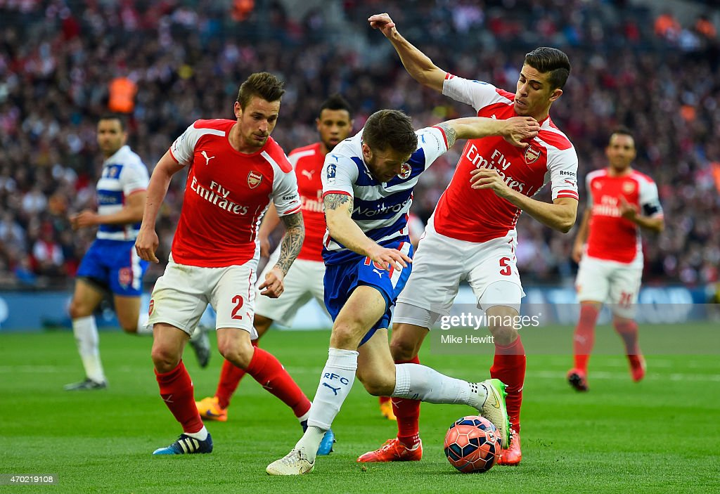 <a gi-track='captionPersonalityLinkClicked' href=/galleries/search?phrase=Gabriel+Paulista+-+Soccer+Centre+Back+-+Born+1990&family=editorial&specificpeople=13864275 ng-click='$event.stopPropagation()'>Gabriel Paulista</a> and <a gi-track='captionPersonalityLinkClicked' href=/galleries/search?phrase=Mathieu+Debuchy&family=editorial&specificpeople=729104 ng-click='$event.stopPropagation()'>Mathieu Debuchy</a> of Arsenal closes down <a gi-track='captionPersonalityLinkClicked' href=/galleries/search?phrase=Jamie+Mackie&family=editorial&specificpeople=5545546 ng-click='$event.stopPropagation()'>Jamie Mackie</a> of Reading during the FA Cup Semi Final between Arsenal and Reading at Wembley Stadium on April 18, 2015 in London, England.