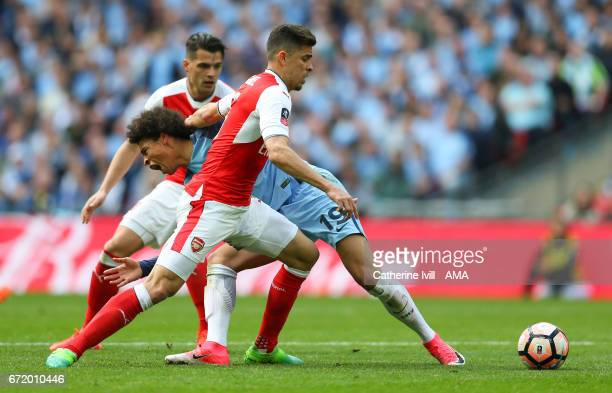 Gabriel Paulista of Arsenal and Leroy Sane of Manchester City during the Emirates FA Cup semifinal match between Arsenal and Manchester City at...