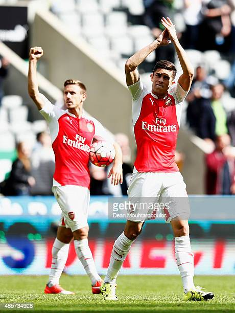 Gabriel Paulista of Arsenal and Nacho Monreal of Arsenal salute the fans after the Barclays Premier League match between Newcastle United and Arsenal...